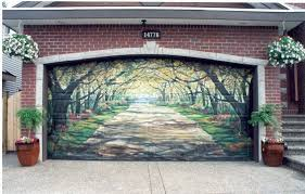 how to paint a garage door in 7 simple steps a red brick home has a garage door that has been painted to look like a home interior design