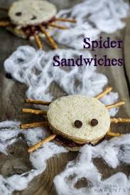 spreading peanut butter jelly spider sandwiches we u0027re parents