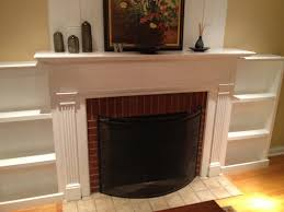 brown brick fireplace with white mantel and shelf between white