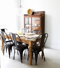 Matte Black Chairs With A Rustic Wooden Table From Pineapple Life - Black wood dining room chairs