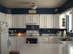 terracotta properties kitchens navy blue walls chair rail