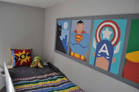 classy small bedroom design with superhero wallpaper and stripped