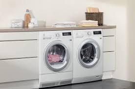 lave linge dans la cuisine sèche linge à pompe à chaleur pourquoi le choisir darty vous
