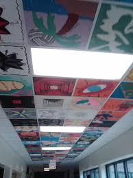 your guide to painting ceiling tiles for interior update