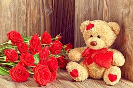 valentines day teddy valentines day teddy loving with bouquet of roses stock