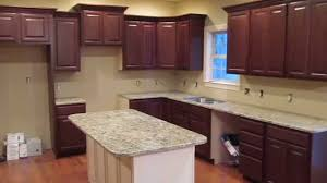 job walk through oak cabinets with painted island by summit