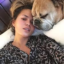 chrissy teigen knows her dog still loves her without makeup on photo insram chrissy teigen
