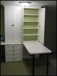 craft cabinet with fold out table craft room storage ideas craft room organization by storage