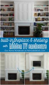 built in fireplace surround and shelving with hidden tv nook