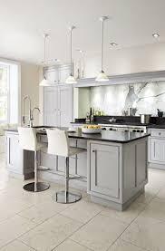 grey kitchen units with black granite worktops pin by mcdermott on kitchen classic kitchens granite