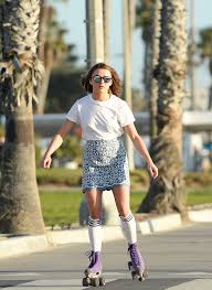 maisie williams in mini skirt roller skating 18 gotceleb