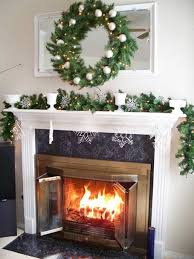 decorate over fireplace with vines and wreath and mirror