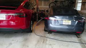 tesla model s charging tesla model x u0026 model s charging in garage youtube