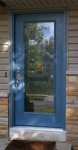 appealing entry door with lite combined blue accent color and