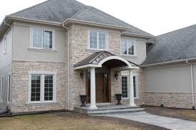Home Exterior Design Stone Homes With Stacked Stone And Stucco Exterior Duckdo Cream Wall