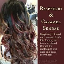 black hair to raspberry hair raspberry caramel blonde foils dark brown base dyed hair