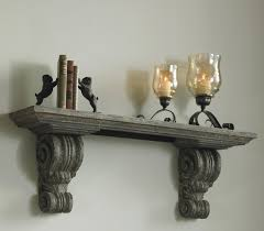 decorative wood wall shelf with carved accent and gray color