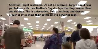 mother marches through target with her family to protest