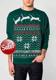 sweater cat jumping in snow pullover cat