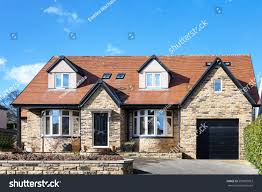 beautiful english bungalow red roof stock photo 599882063