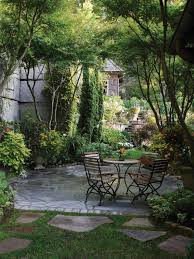 a stone patio shaded by trees is an ideal outdoor setting for a