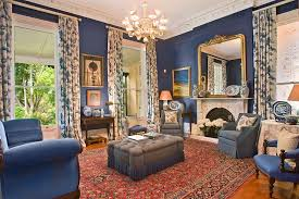 blue living room design with gold carameloffers