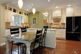 kitchen with granite island and table stock photo picture and