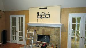 mantelmount fireplace tv mount above no studs how hide cable box