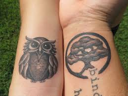 temporary owl tattoo near wrist real photo pictures images and