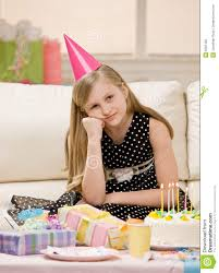 unhappy unhappy in party hat sits with gifts stock photography