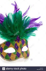 mardi gras feathers a purple gold and green mardi gras mask with feathers on a white