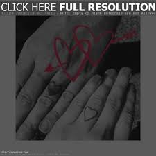 wedding rings problems with finger tattoos how much does a