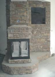 protruding stone veneer fireplace ocala stone finish fabricated stone fireplace and wall feature