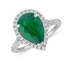 emerald engagement ring emerald pear shape and halo cocktail ring in platinum