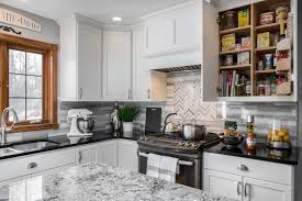 white kitchen cabinets with black quartz space saving shelves white kitchen cabinets black quartz