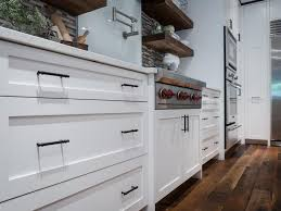 shaker style kitchen cabinet pulls white shaker style cabinetry with rubbed bronze drawer
