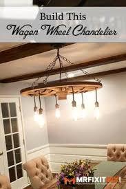 Diy Wagon Wheel Chandelier Wagon Wheel Chandelier With Edison Bulbs By Thehoneydew On Etsy