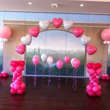 wedding arch balloons pretty heart arch on fishing line and sparkle walkers on the