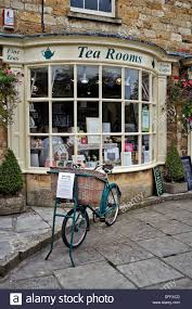 bow window stock photos images alamy traditional english tea room exterior with bow window and vintage bicycle display bourton the
