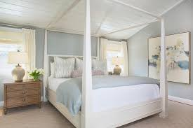 white canopy bed with gray bedding transitional bedroom