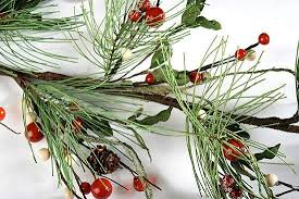 icy winter pine and white berry garland with pine cones