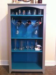 painted open diy liquor cabinet with hanging glass rack and shelf