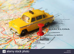 Tarragona Spain Map close up of tarragona spain map and a taxi toy travel concept