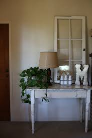 rustic farmhouse entry table old window used as table and wall