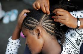 suspends hair policy bowing to protests