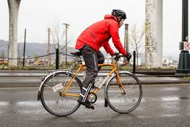 best road bike rain jacket biking in the rain gear tips and gentle encouragement momentum mag