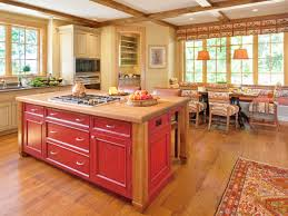 yellow kitchen with island and yellow wood with red and green