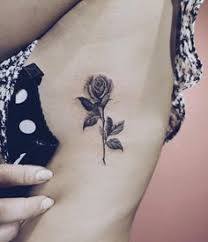 black ink rose on rib cage u2014 tattoos on women u2014 pinterest