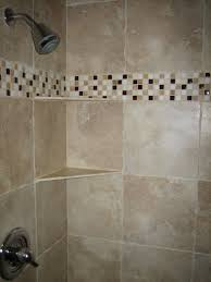 bathroom tile designs glass mosaic beige granite shower wall panel combined with glass mosaic subway tiled added chrome metal mount faucet bathroom tile design ideas