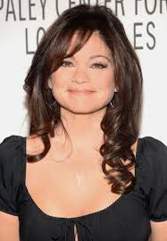layered hair styles for round face over 50 layered long hairstyle with waves for women valerie bertinelli s
